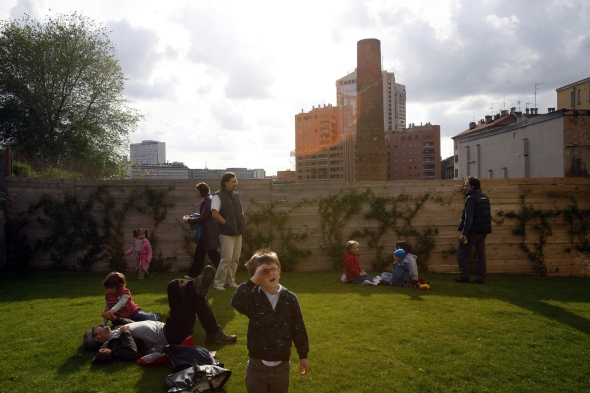 april 2008. A boy watching the sky in an area surrounded by construction sites.